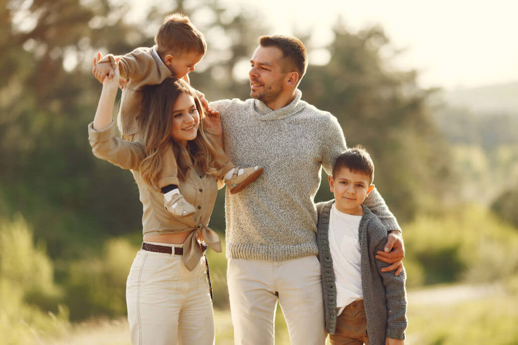 cute family playing summer field 2 1030x687
